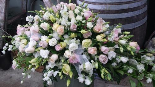 1. Casket Flowers Pastels