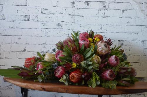 37.Half casket of Native Flowers