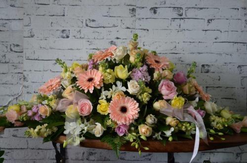50.Mixed seasonal casket spray of pastel flowers